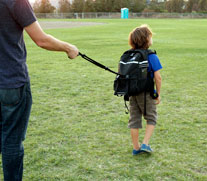 Teacher securing child with long handle on SIPE-pack
